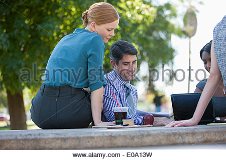 Business people working in park - Stock Photo