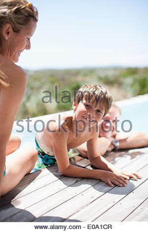 Family swimming in pool - Stock Photo