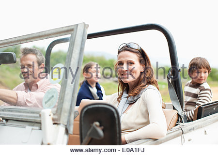 Family riding in vehicle - Stock Photo