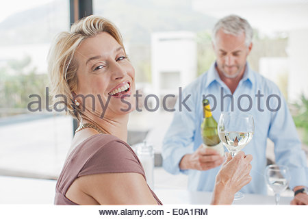 Mature couple drinking white wine - Stock Photo