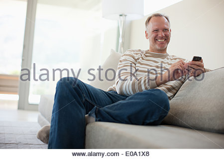 Man text messaging on cell phone - Stock Photo