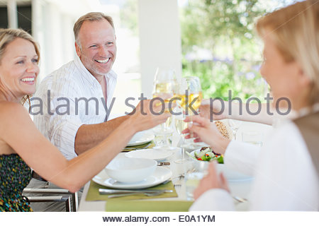 Friends making toast with wine glasses - Stock Photo