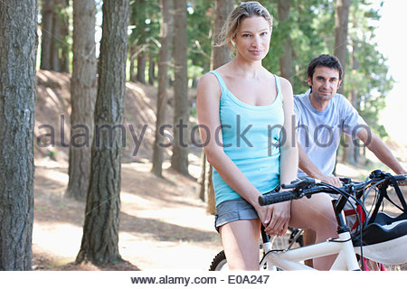 Couple bicycle riding in remote area - Stock Photo