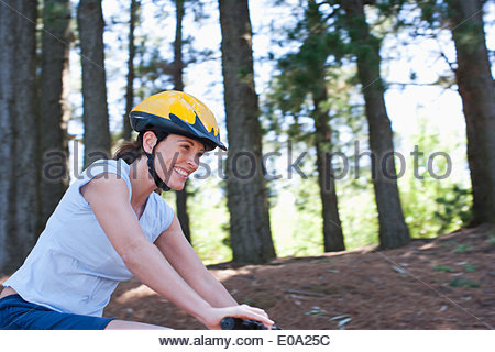 Woman bicycle riding in remote area - Stock Photo