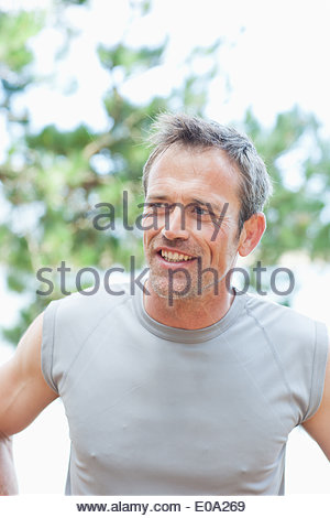 Man with hands on hips smiling - Stock Photo