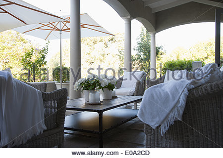 Table and chairs on patio - Stock Photo