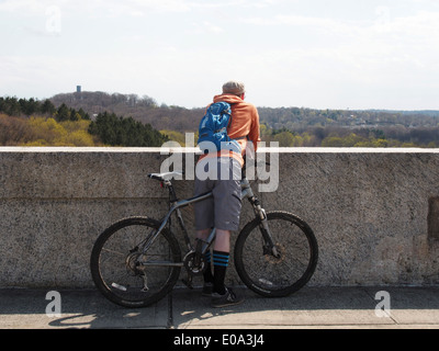 Bicyclist stops to enjoy the view from atop the Kensico Dam, Valhalla, New York, USA, April 26, 2014, © Katharine - Stock Photo
