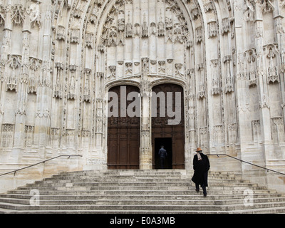 People entering the Cathedral in Beauvais, France - Stock Photo