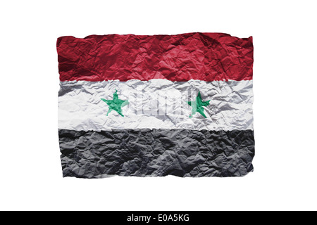Close up of a curled paper on white background  print of the flag of Syria - Stock Photo
