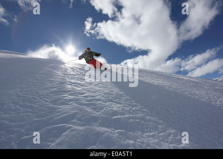 Mid adult man skiing downhill, Mayrhofen, Tyrol, Austria - Stock Photo
