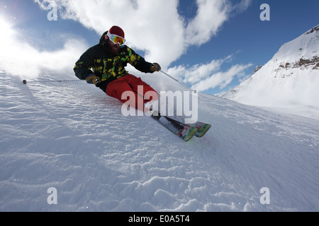 Mid adult man skiing at speed downhill, Mayrhofen, Tyrol, Austria - Stock Photo