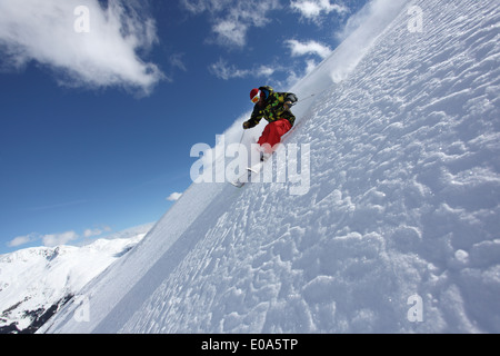 Mid adult man skiing on steep slope, Mayrhofen, Tyrol, Austria - Stock Photo