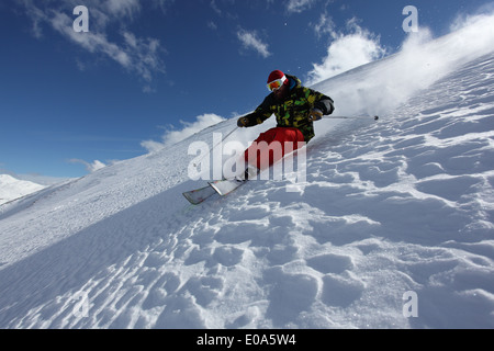 Mid adult man skiing down steep slope, Mayrhofen, Tyrol, Austria - Stock Photo