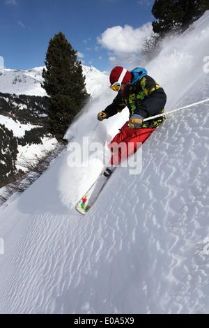 Mid adult man skiing down steep mountain, Mayrhofen, Tyrol, Austria - Stock Photo