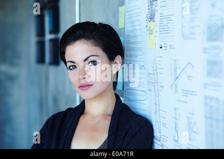 Portrait of ambitious young businesswoman in office - Stock Photo