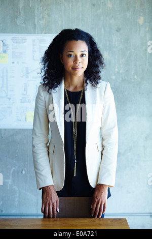 Portrait of calm young businesswoman in office - Stock Photo