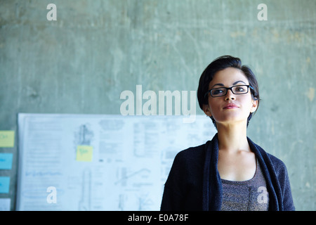 Portrait of serious young businesswoman in office - Stock Photo