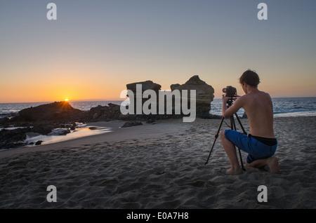 Teenage boy taking photos, Table Rock Beach, Laguna Beach, California, USA - Stock Photo