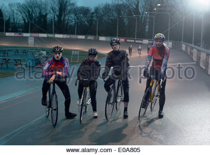 Portrait of young adult cyclists at velodrome - Stock Photo