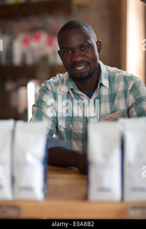 Portrait of young man sitting in cafe - Stock Photo