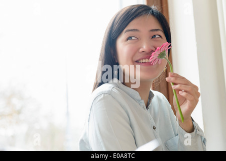 Woman smelling flower - Stock Photo