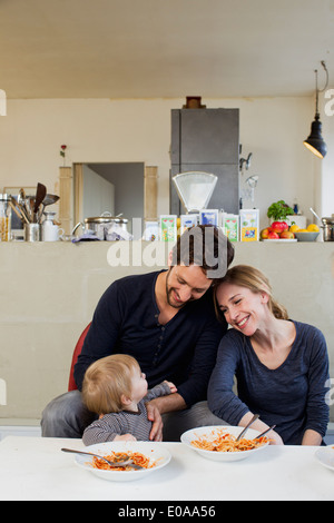 Family with baby girl eating spaghetti meal