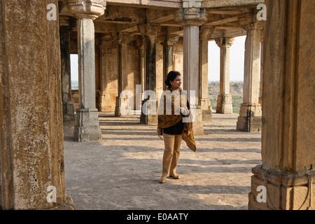 Indian woman in Kabutarkhana Pavilion, Champaner-Pavagadh Archaeological Park, Gujarat, India - Stock Photo