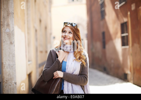 Young sophisticated woman exploring streets, Rome, Italy - Stock Photo
