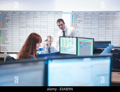 Engineers working together in office - Stock Photo