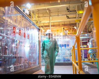 Engineer walking in acid and caustic plant in power station - Stock Photo