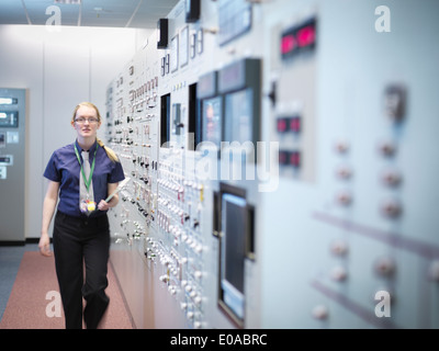 Female engineer in nuclear power station control room simulator - Stock Photo