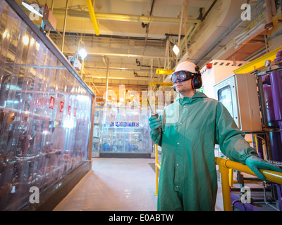 Engineer working in acid and caustic plant in power station - Stock Photo