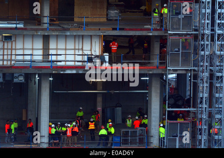 Builders works on New building construction site in Melbourne Victoria Australia - Stock Photo