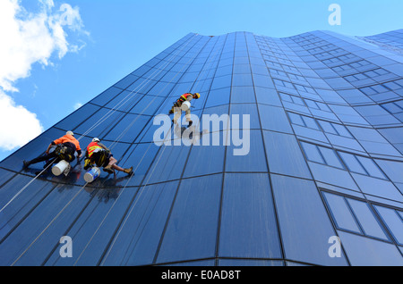 Window cleaners works on high rise building. - Stock Photo