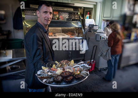 Cafe Turino , Waiter with Seafood platter, Place Garibaldi, Nice - France, Cote d' Azur France Nice- France Alpes - Stock Photo