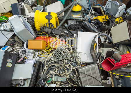 Small electrical appliances laying in a recycling container, London, UK - Stock Photo