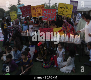 LAHORE, PAKISTAN, MAY 07: Pakistani workers of Political party pakistan tehreek-e- Insaf(PTI )and Thalassemia affected - Stock Photo