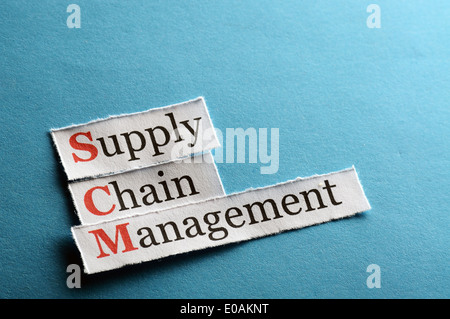 SCM Supply Chain Management acronym on blue paper - Stock Photo