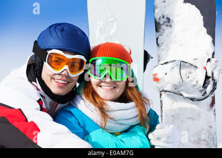 Man and woman in ski mask smiling - Stock Photo