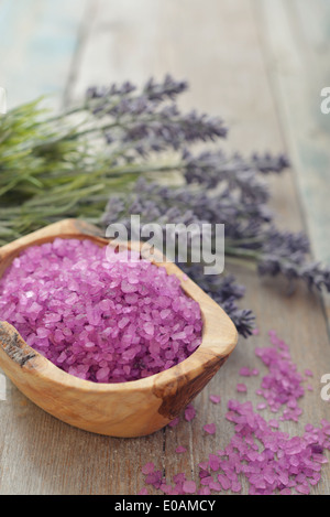 Bouquet lavender with sea salt on wooden background closeup - Stock Photo