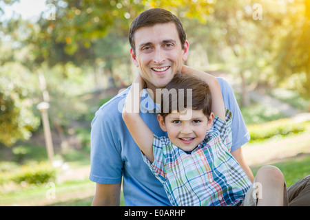 Handsome Mixed Race Father and Young Son Portrait in the Park. - Stock Photo