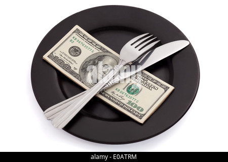 Money on plate with fork and knife on white background - Stock Photo