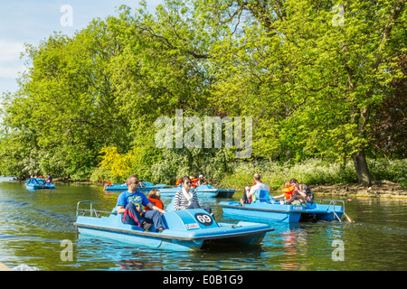 Pedalo boats on the lake in Regents Park London,England UK - Stock Photo