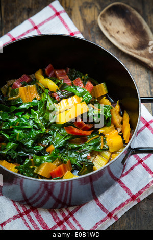 Cooked red and yellow mangold in a pot - Stock Photo
