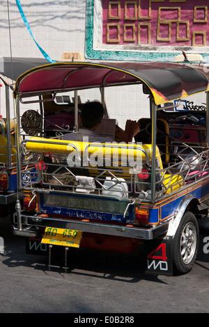 Tuk Tuk on the streets of Bangkok, Thailand - Stock Photo
