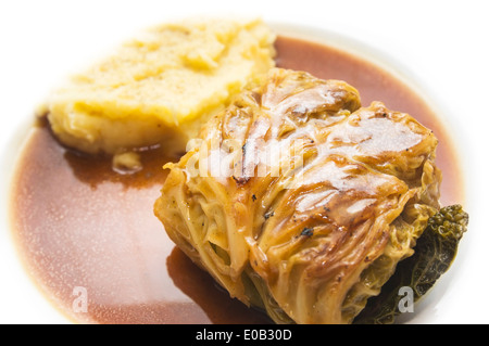 cabbage rolls with potatoes Mashed on white background - Stock Photo
