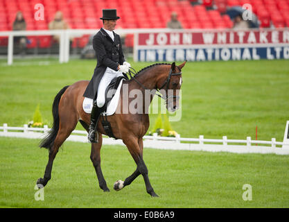 Badminton, UK. 08th May, 2014. Mark Todd [NZL] riding NZB Campino take the early lead during the dressage phase - Stock Photo