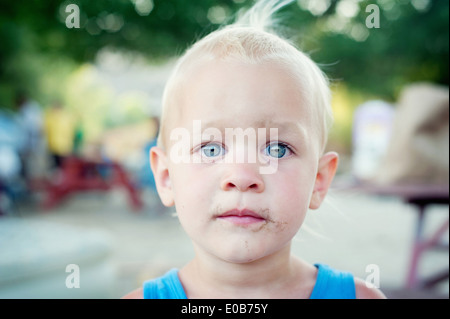 Close up portrait of blue eyed male toddler - Stock Photo