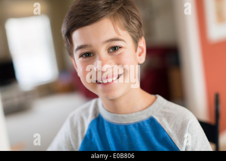 Portrait of smiling boy at home - Stock Photo