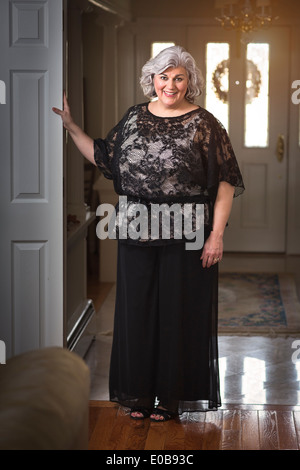 Portrait of well dressed mature woman in hallway - Stock Photo